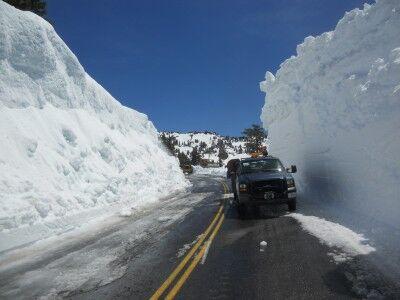 Truck next to snowbank at Lassen Volcanic National Park